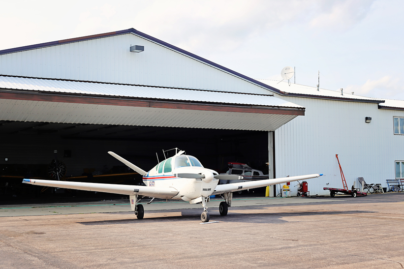 Cub Plane in Front of Hanger